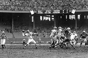 Otto Graham goes for a pass in Cleveland's Municipal Stadium. (Getty Images)