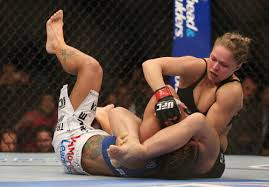 Ronda Rousey applies the armbar on Liz Carmouche at UFC 157. (Getty Images)